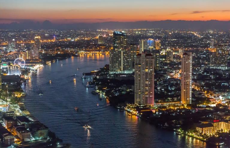 Bangkok Night Skyline and Chao Phraya River view from the State Tower Bangkok, Thailand